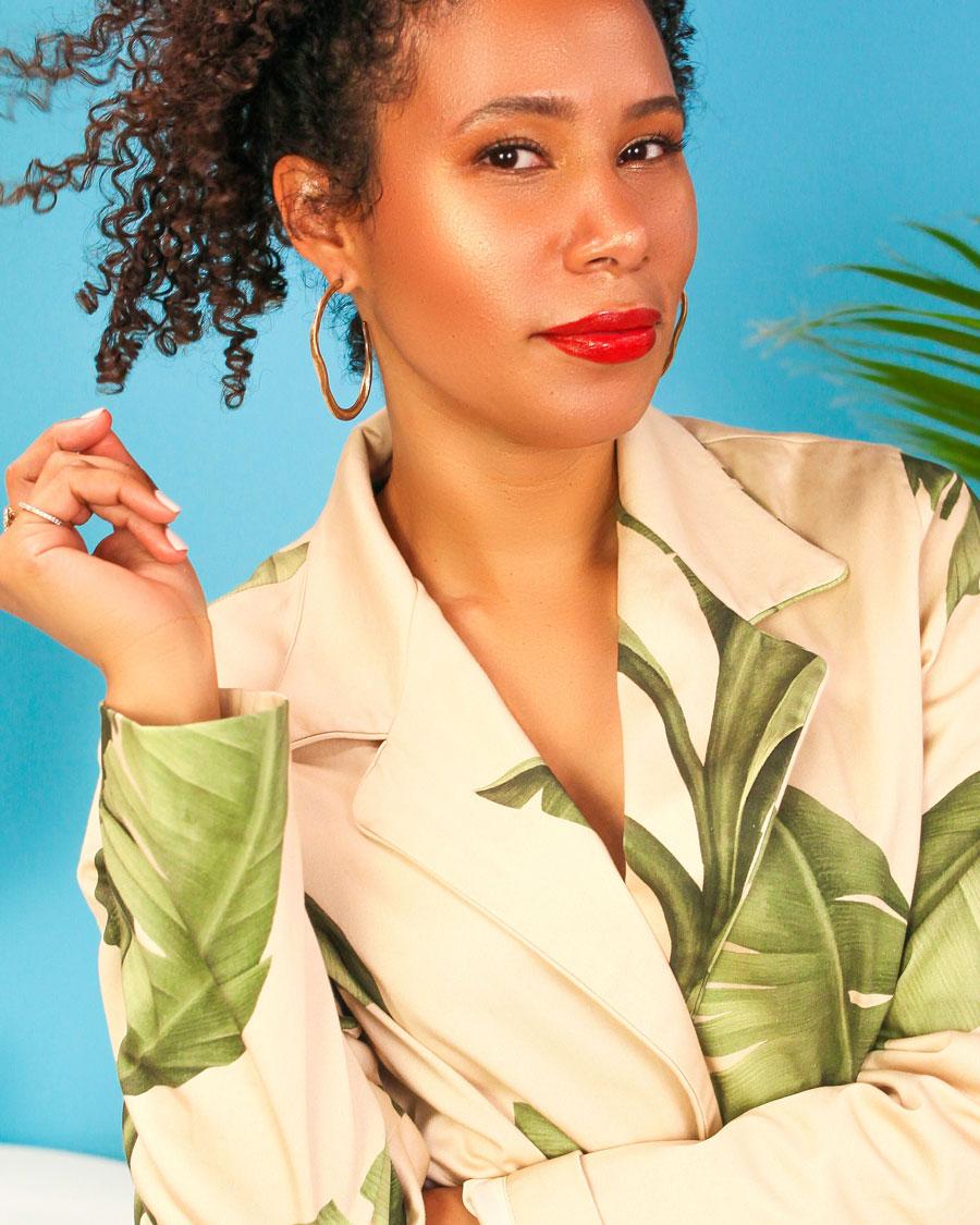 Founder of Bomba Curls Lulu Cordero wearing a palm-print blazer